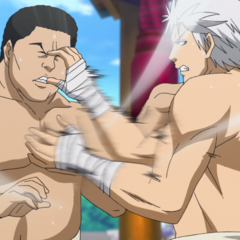 Yūma beats an opponent with a series of slaps.