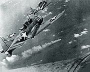 220px-SBD-3 Dauntless bombers of VS-8 over the burning Japanese cruiser Mikuma on 6 June 1942