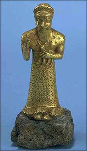 Elamite worshipper gold