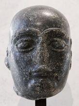450px-Gudea shaven head Louvre AO12 2