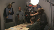 Bruno Ganz points at map