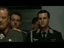 Hitler planning scene Mohnke enters the room behind Nicolaus von Below