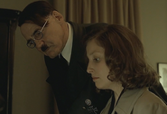 Hitler checks Traudl's writing