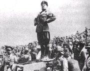 Mussolini standing on a tank
