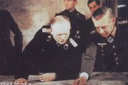 Walther Wenck points at a map and Heinz Guderian looks