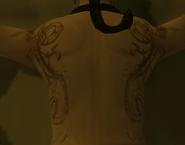 Татуировки спине представителя Красного Дракона