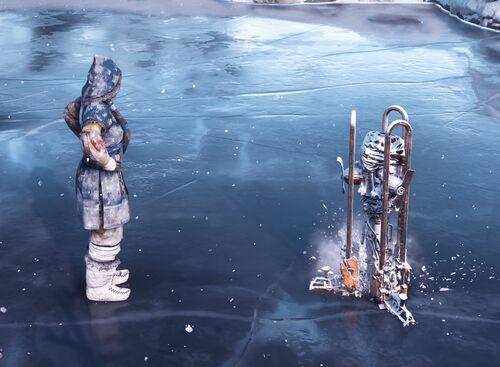 Banuk using Powered Ice Auger