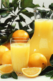 393px-Oranges and orange juice
