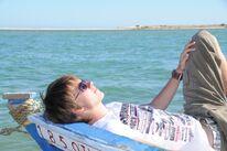 Patrick Baehr chillt on the boat