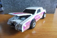 Hot Wheels 1986 2557 Crack-ups Knocker Stocker Buick Regal white with yellow, orange, purple Stripes 'Zap' made in Malaysia d
