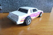 Hot Wheels 1986 2557 Crack-ups Knocker Stocker Buick Regal white with yellow, orange, purple Stripes 'Zap' made in Malaysia g