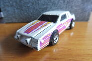 Hot Wheels 1986 2557 Crack-ups Knocker Stocker Buick Regal white with yellow, orange, purple Stripes 'Zap' made in Malaysia c