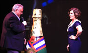 John Heald introduces actress Marcia Gay Harden on Carnival Dream