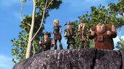The gang looking down to where Hiccup fell to