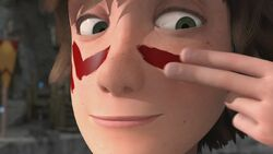 Hiccup puting face paint on