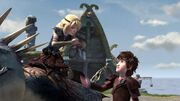 Hiccup having just handed Astrid something