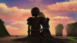 Hiccup and Astrid with their arms around each other