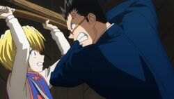 Kurapika blocks Leorio's attack
