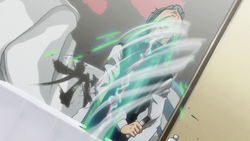 A close up of Leorio punching Ging