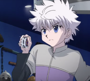 Killua attacks with his yoyo