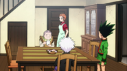 Gon with his Aunt, Grandmother and Killua upon arriving home
