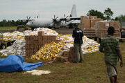 Lives were lost and major bridges, water supplies, crops and villages in Oro Province were destroyed by flooding associated with Cyclone Guba. Australia responded with relief supplies and Defence aircraft, 2007. (1
