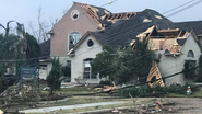 EF1 damage to a home in New Orleana