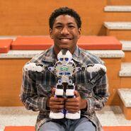 Bryon with his robot S1E3