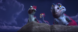 Gavin, Gertie, and Roger looking at something off a cliff