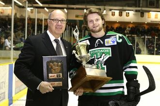Tanner Jago accepting Top Defenseman award