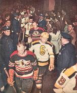 Bruins Hawks onto ice-1948
