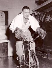 1957March-Toppazzini on bike