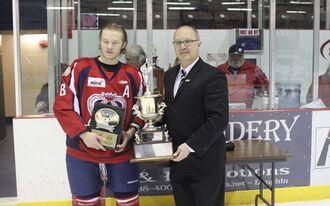 Tanner Butler accepting Top Defenseman award