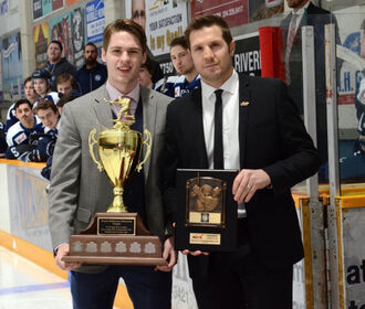 Drew Worrad receives Frank McKinnon Memorial Trophy