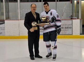 Shane Luke receives Mike Ridley Trophy