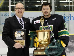 Adam Iwan accepting Top Goaltender Award