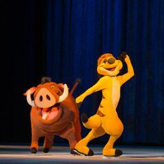 Timon and Pumbaa performing