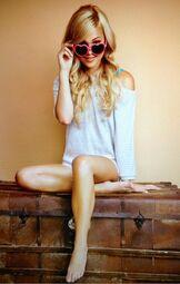 Olivia Wearing Pink Heart Sunglasses