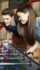 Peyton and piper playing foosball