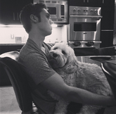 Austin black and white pic with his dog