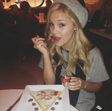 Olivia Holt with Strawberries