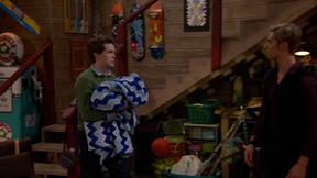 Garrett Carrying a Quilt
