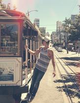 Austin Holding onto Bus