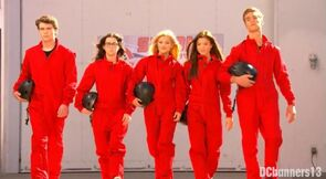 The gang wearing red suits