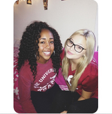 Olivia Wearing Glasses and with a Friend