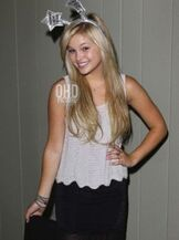 Olivia holt 2012 photo shoot picture 5 smiling whit a siver hair band