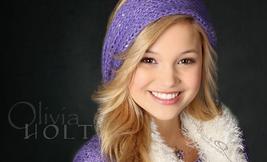 Olivia Holt Smiling in Purple