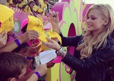 Olivia Signing Autographs