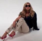 Blue top, round sunglasses Olivia