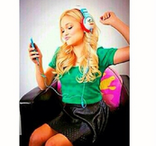 Olivia in a green top with paul frank headset